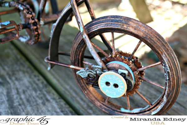 Loving these details on Miranda's Come Away with Me carriage. She used chipboard and metal keyholes to embellish this wheel! #graphic45