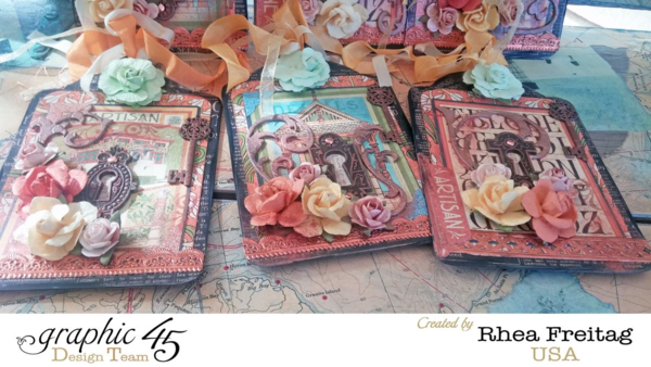Gorgeous florals and riboon on these tags by Rhea using Artisan Style. Love how she used the Metal Keys & Keyhole Staples on each one! #graphic45